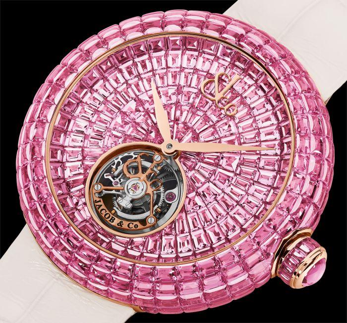 a close up of a pink umbrella