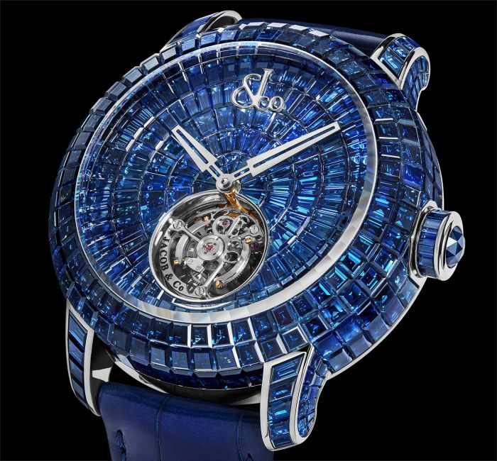 a blue and gold clock in the middle of a watch