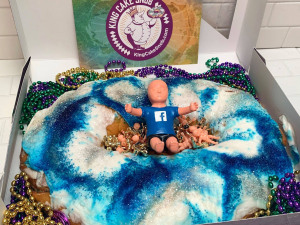 King Cake Snob Delivers a Fully Dressed King Cake Baby to Facebook?s Zuckerburg